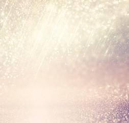 glitter vintage lights background. gold, silver, blue and white. de-focused.