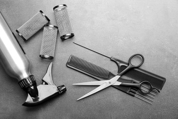 Barber set with tools and cosmetic on grey background