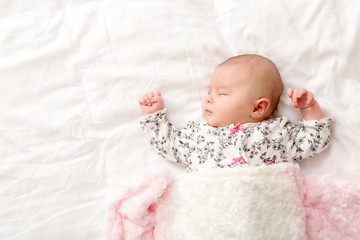 Newborn baby girl on her blanket