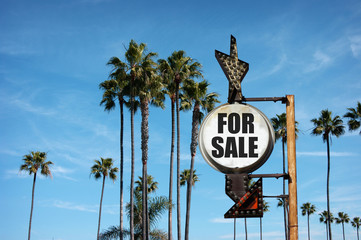 vintage for sale sign with palm trees