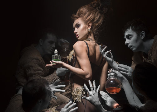 Woman in beautiful lingerie in an old laboratory. Scary perfumers offer a new flavor.