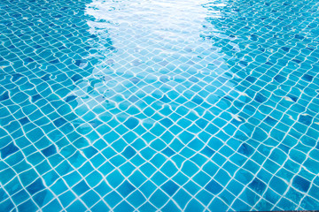 blue swimming pool with sunny reflections abstract for backgroun