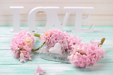 Pink flowers, wooden word love and decorative heart
