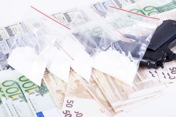 drugs,money,cocaine and gun