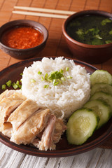 Hainanese chicken rice close-up, chili sauce and broth. vertical