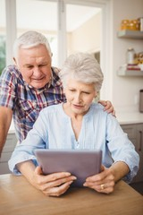 Senior couple looking at a digital tablet