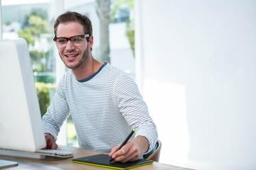 Handsome man working on computer