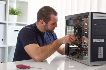 Man repairing computer Wall mural