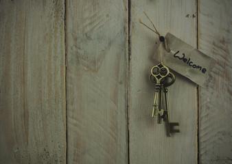 Antique keys on wooden background