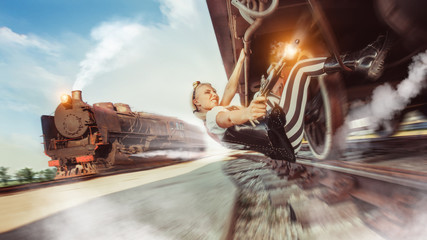 Sexy woman with the gun is trying to stop the train.