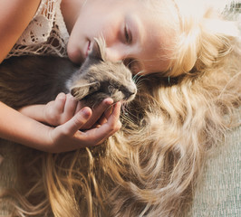 Baby girl hugging kitten, pet, friend, lifestyle