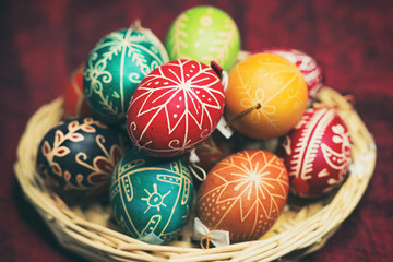 Vintage style photo from decorated Easter eggs in a basket with traditional hungarian patterns