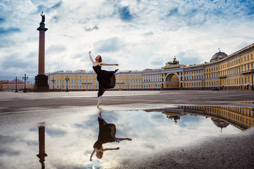 The young woman, the ballerina dances on the square