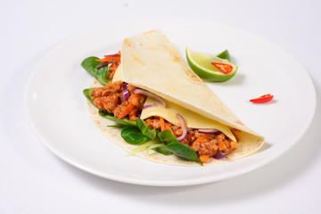 Tacos on a white plate