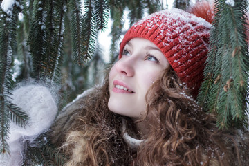 Attractive young woman looking at a tree