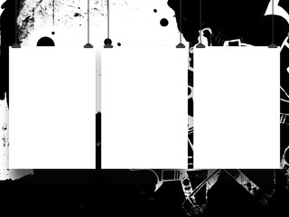 Close-up of three hanged paper sheets with clips on black and white ink splotchy background