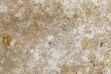 Closeup abstract background texture photo of yellow brown marble with natural limestone pattern