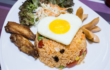 Close up American fried rice served with green cos lettuce