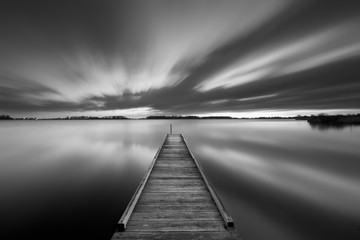 Jetty on a lake in black and white