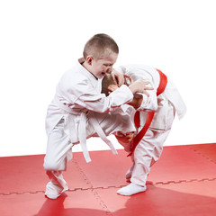 The five-year children  are training judo throws