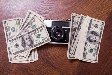 camera and money,business plan, money background, hundred dollar bills front side. opyspace, the work of the photographer, the photographer, earnings in photos