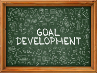 Goal Development - Hand Drawn on Chalkboard. Goal Development with Doodle Icons Around.