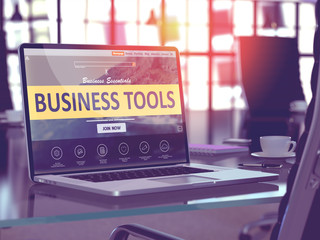 Business Tools Concept. Closeup Landing Page on Laptop Screen  on background of Comfortable Working Place in Modern Office. Blurred, Toned Image. 3D Render.