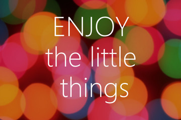 Enjoy the little things text on colorful bokeh background