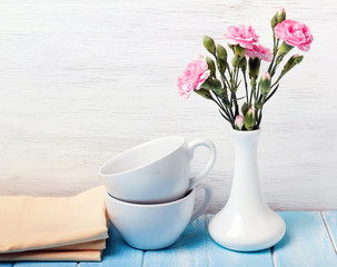 Cups, vase and flowers