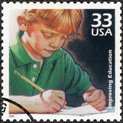 USA - 2000: Child writing, improvement in quality of education