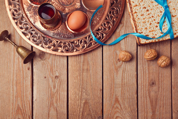 Passover background with matzo, wine and old seder plate. View from above