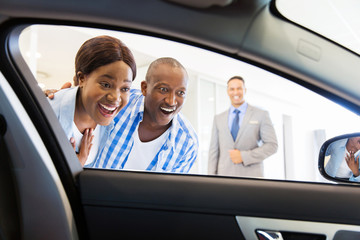 african couple choosing luxury car