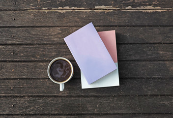 Coffee and books on wood table