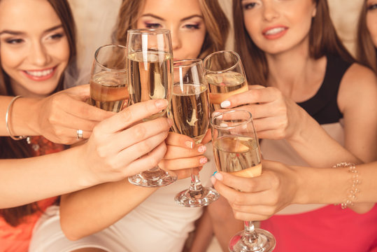 Close up photo of girls celebrating a bachelorette party and cli