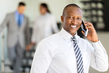 african business executive talking on mobile phone