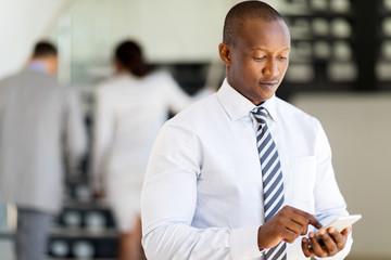 african business man using smart phone