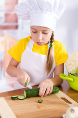 girl cook cutting the vegetables
