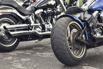 rear tyre and exhaust pipes of a classic American motorcycle