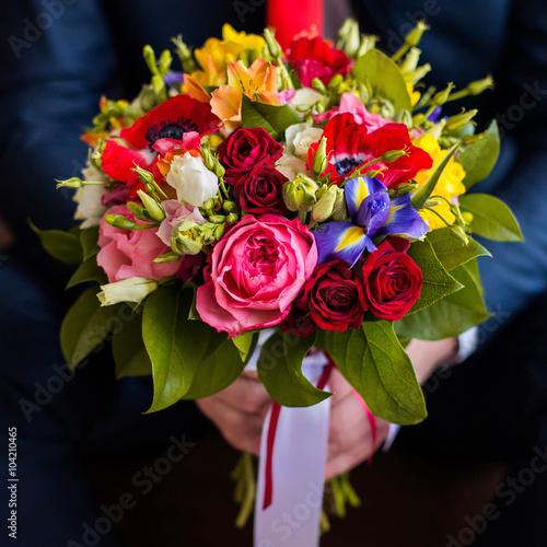 Wedding flowers groom holds bouquet of white blue yellow flowers wedding flowers groom holds bouquet of white blue yellow flowers and red roses mightylinksfo