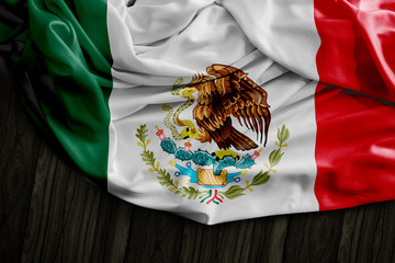 Mexican flag on wooden table