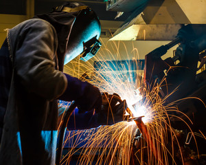 welding worker in the automotive part in factory