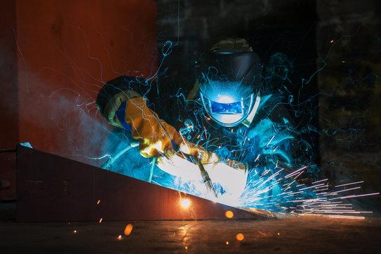 worker welding metal