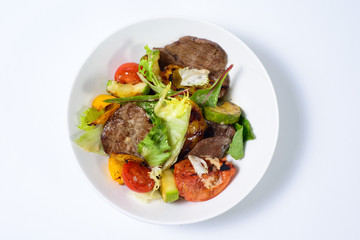 salad with meat,egg, tomatoes, olives and vegetables