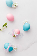 Pastel Easter eggs. Easter background with pastel colored  eggs with pink and blue  bow and ribbon.