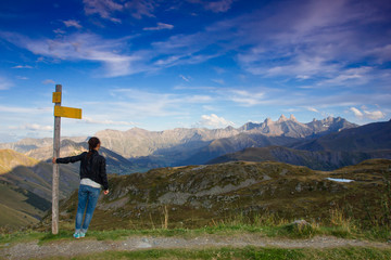 The girl standing at the viewing point in the French Alps