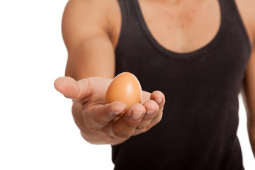 Egg in muscular Asian man's hand