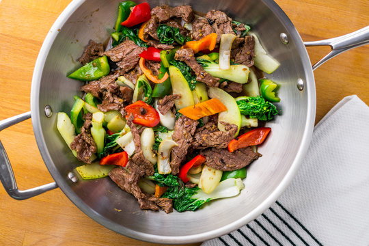 Beef stir fry top view. Healthy vegetable & beef stir-fry. Made with flank steak, peppers, onions and bok choy stir fried in an asian wok.