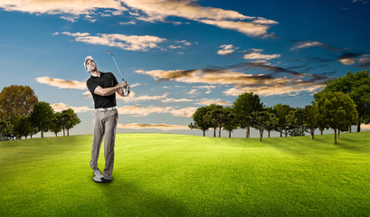 Golf Player using a black uniform.
