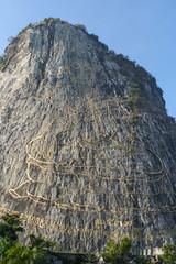 Golden Buddha on the rock