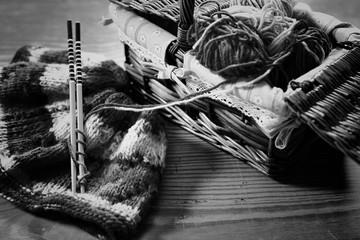 monochrome wool and knitting needles
